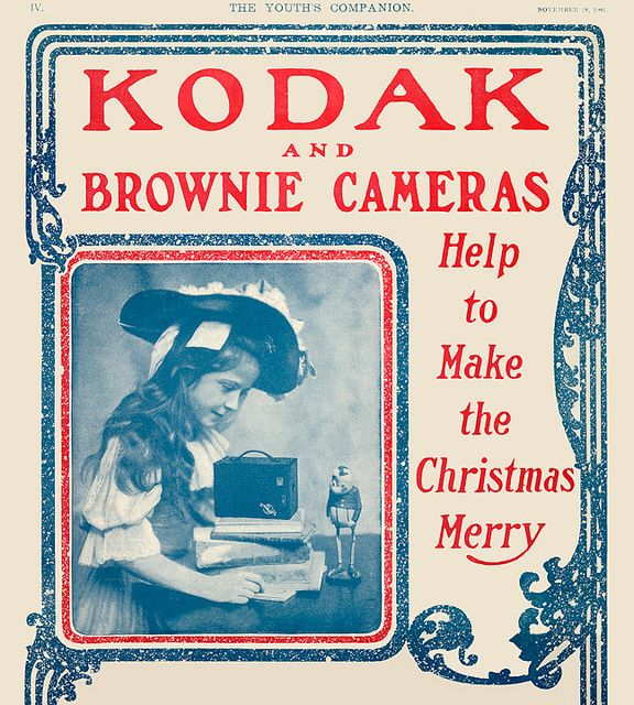 Kodak Brownie Camera Christmas Ad - 1901    A beautiful little girl photographs a toy Palmer Cox Brownie with her Kodak Brownie Camera in this ad from The Youth's Companion magazine, November 1901.
