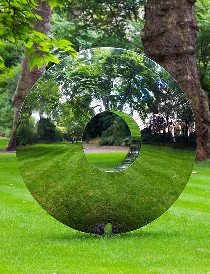 The mirrored doughnut lawn sculpture out front would make for a great portal. Or…