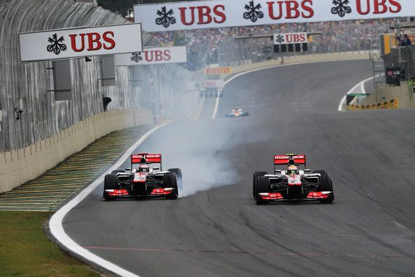 Lewis Hamilton (R) of Great Britain and McLaren and team mate Jenson Button (L) of Great Britain and McLaren drive side by side during the Brazilian Formula One Grand Prix