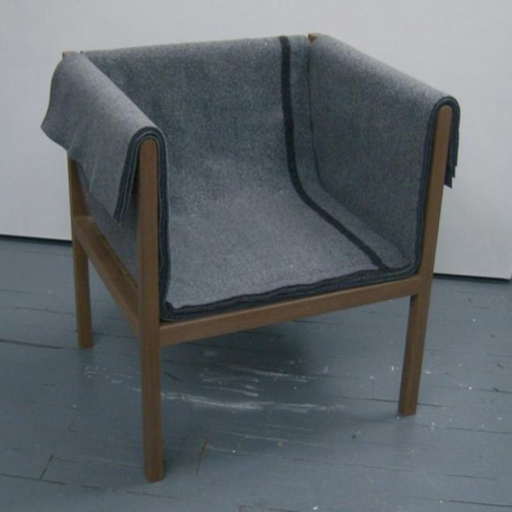 Blanket Chair by Heidi Earnshaw | Solid walnut with felted military blankets. Secret Pocket | at MADE