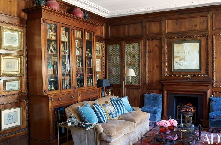 The drawing room, with pine paneling and a 19th-century mahogany bookcase, has a clublike air