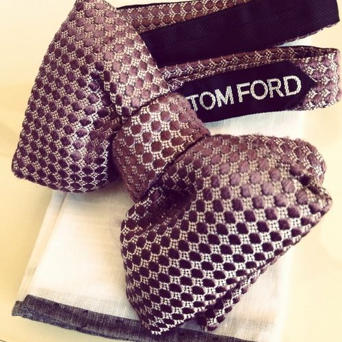 Tom Ford bow tie. Since most are vintage or second hand, it is rare to see such a svelt bow tie in rich pattern and colour. I would love to see this paired with an excellent shirt and a grey coat.