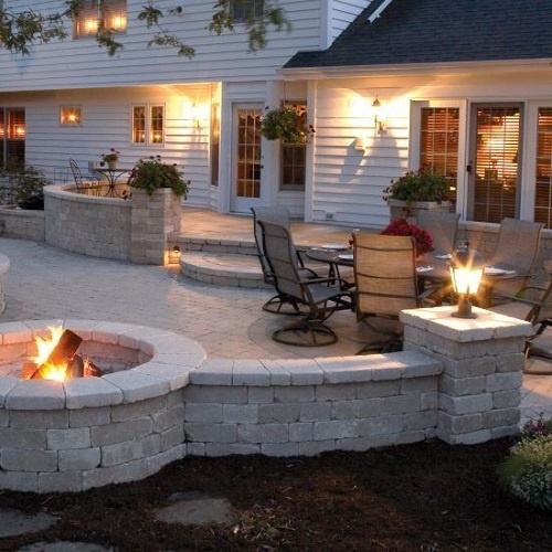 White brick patio with built in firepit.