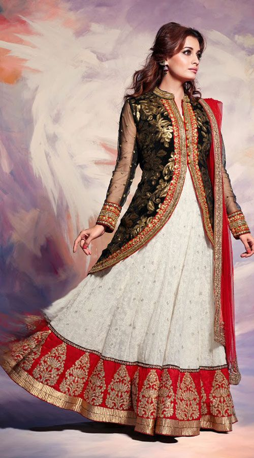 Modelled by Dia Mirza, This faux georgette and jacquard bollywood lehenga choli in lovely white color with red dupatta which is decked with embroidery work. It has heavy work of lace, resham, sequins and stone done in the skirt and black long choli part which is increasing its nice looks.This unstitched choli can be stitched in the maximum bust size of 42 inches.