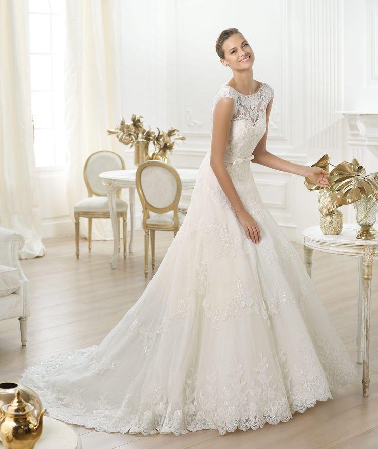 Pronovias presents the Lenit wedding dress. Costura 2014. | Pronovias