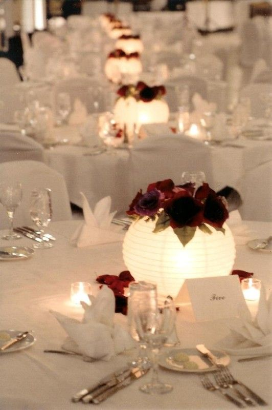 Paper lanterns as light-up centerpieces - nice idea.  Place lantern over a clear drinking glass with a tea candle inside.