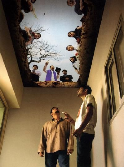 The ceiling mural in a designated smoking area. Very funny.