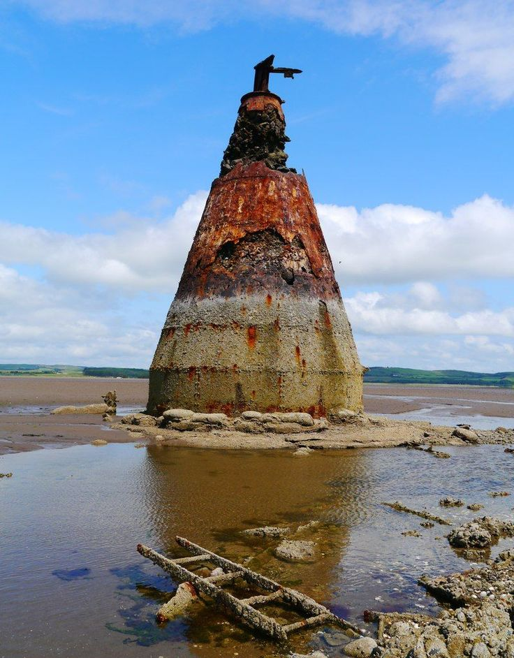 Ruined concrete and metal target tower in Luce Bay.