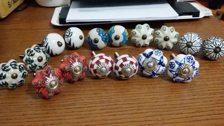 Assorted handpainted knobs for my kitchen cabinets.