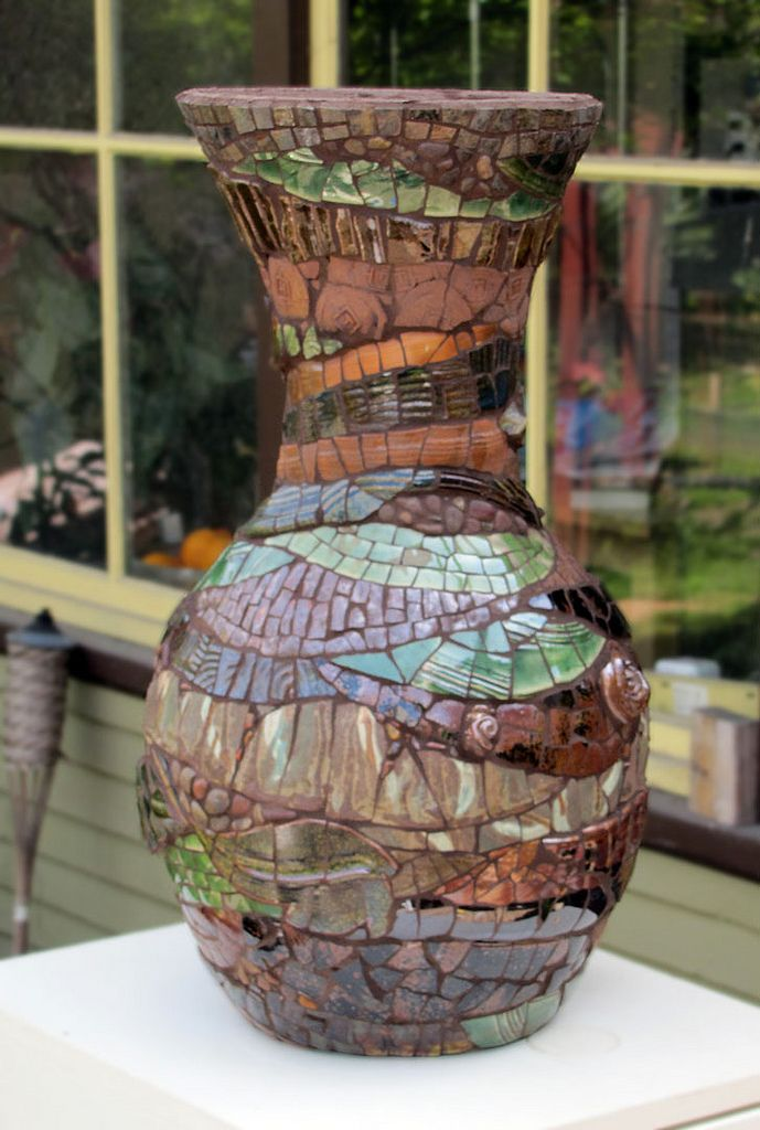 Two ft tall, brown grout, made from discarded ceramics.
