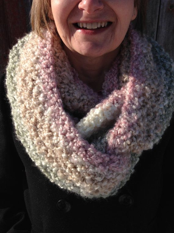 This super soft infinity scarf will keep you toasty warm all winter long! Made with cozy textured yarn in an eye-catching stripe. Colours include cream, beige, soft pink, and sage green. Long enough to wrap around twice!  Measures approximately 8.5 wide and 60 around.  Washer/dryer safe.