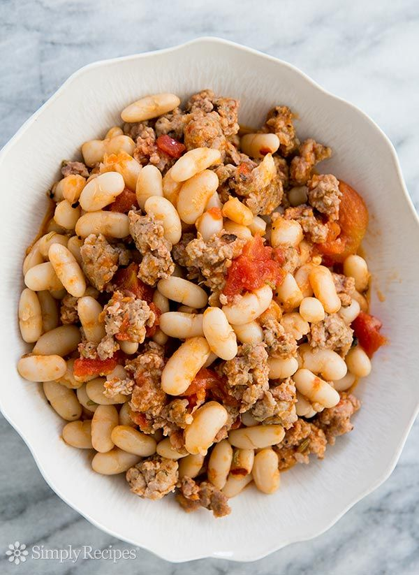 White Beans and Sausage ~ White cannellini beans with Italian sausage in a plum tomato sauce. ~ SimplyRecipes.com