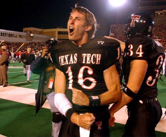 Kliff Kingsbury celebrates with fans after upsetting Texas 42-38.  NOVEMBER 16, 2002 JONES SBC STADIUM