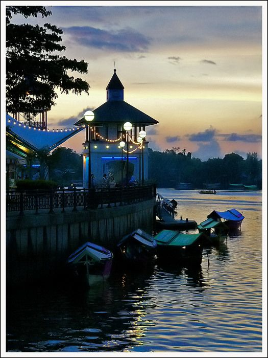 Twlight in historic Kuching, on the banks of the Sarawak River. http://www.travelnation.co.uk/borneo/