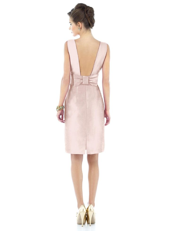 A large statement bow perfectly punctuates the low back of this chic and sophisticated bridesmaid dress.