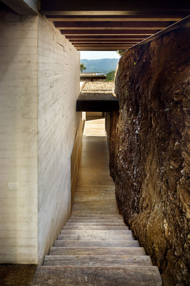 board formed concrete, stone, and timber   Toucan House in Valle de Bravo, Mexico designed by studio Taller Hector Barroso