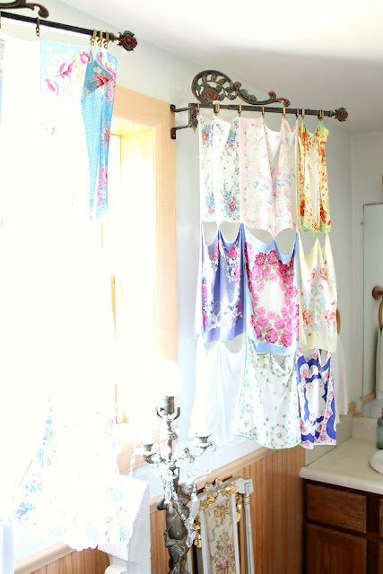 Hankie curtain panels attached to vintage swing arms