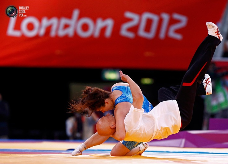 Day 13 - Japan's Saori Yoshida celebrates her victory over Canada's Tonya Lynn Verbeek on the final of the Women's 55Kg Freestyle wrestling at the ExCel venue during the London 2012 Olympic Games. GRIGORY DUKOR/REUTERS