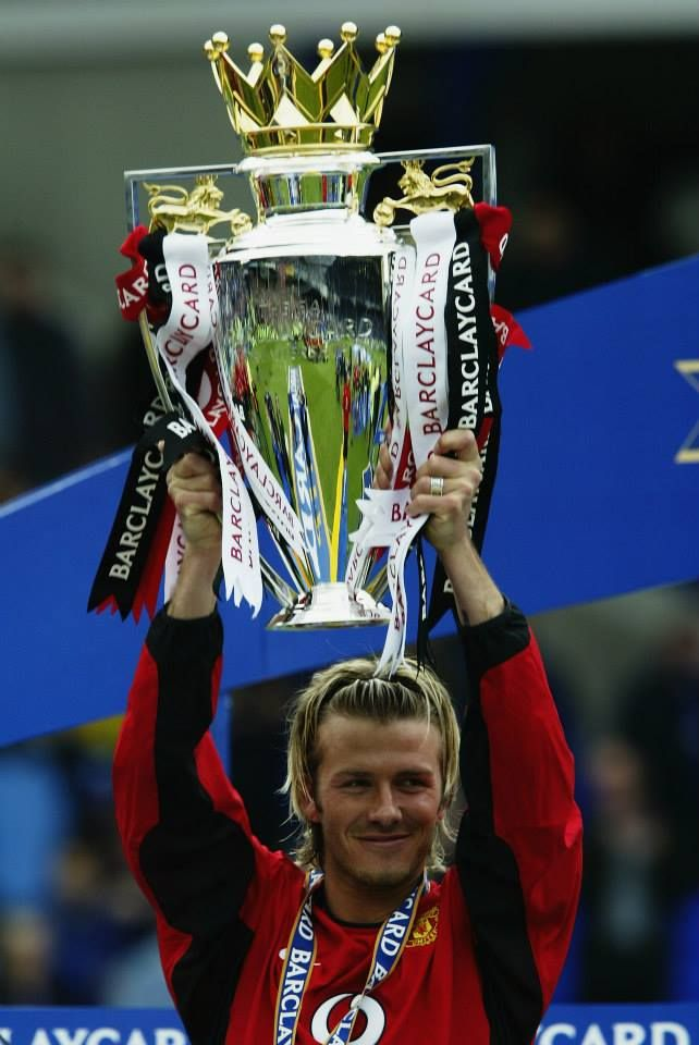 MAY 11: David Beckham lifts the trophy up after the FA Premiership match between Everton and Manchester United held on May 11, 2003 at Goodison Park, in Liverpool, England.