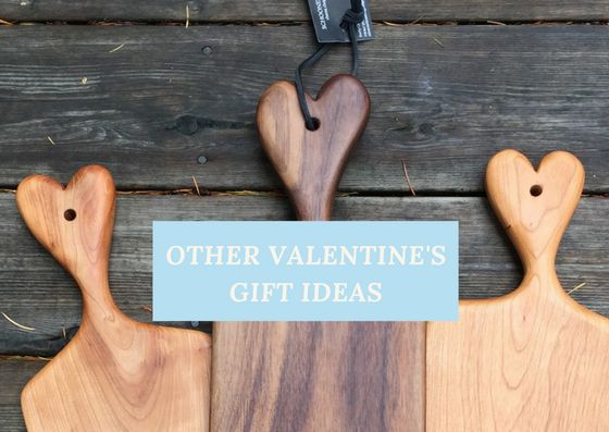 Handcrafted serving boards with adorable heart handles available in black walnut or cherry.