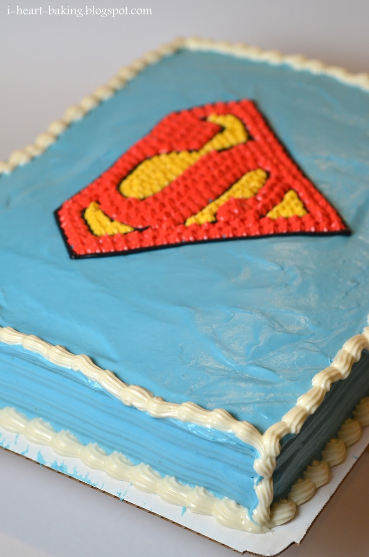 i heart baking!: superman birthday cake - white cake filled with whipped cream and strawberries and covered with cream cheese frosting