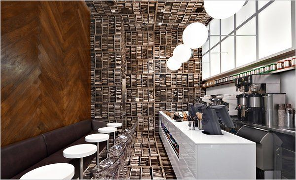 Coffee shop interiors are so important. This one is stylish~ The walls and floors are made to appear like books.
