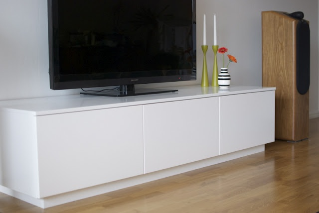 Materials: Faktum/Akurum kitchen cabinets, 16mm MDF, 8 8mm bolts and nuts and the Kreg joinery system.    Description: I wanted a minimalistic media unit with enough room for big receivers and amplifiers, but the ones I could find were either too small or too expensive for me so I decided to build my own using Ikea kitchen cabinets. I went for Faktum/Akurum cabinets and white Applad doors.