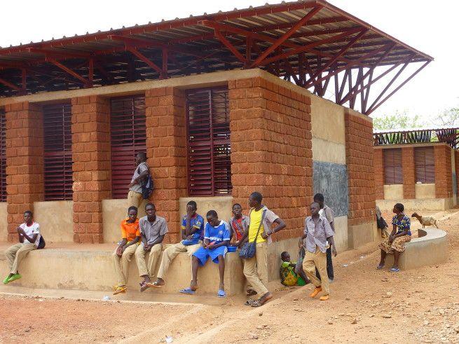 Bethel School, Burkina Faso. Laterite stone masonry construction. Architects: Article 25