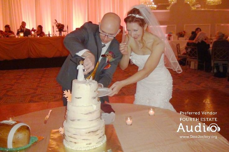 """Andrew and Caitlin cut their cake to """"Love You Madly' by -- you guessed it -- Cake."""
