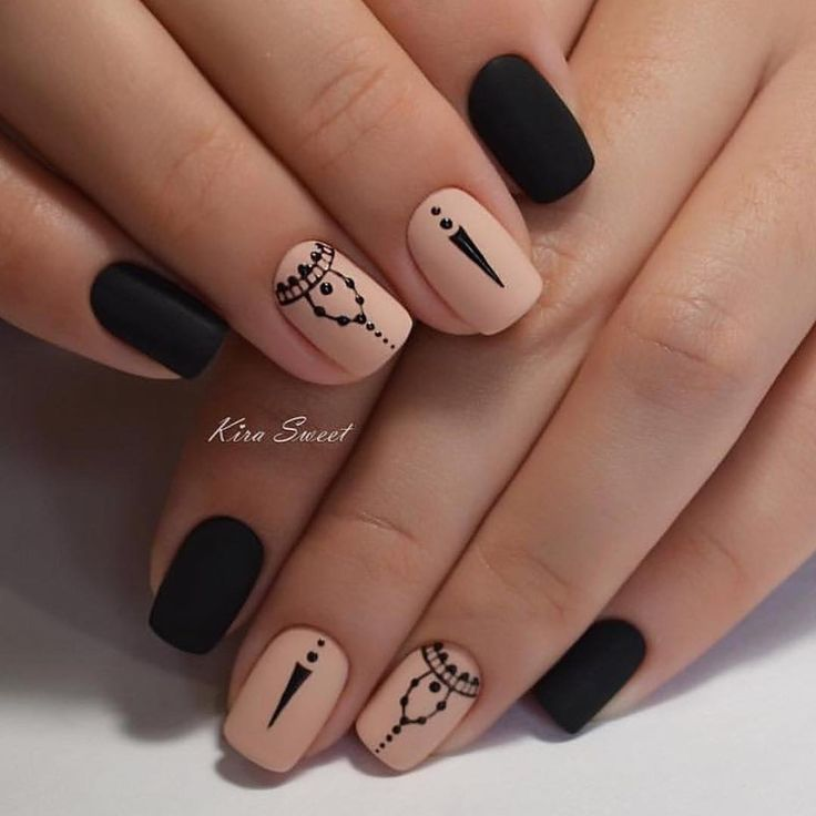 Black and nude nails with design's.