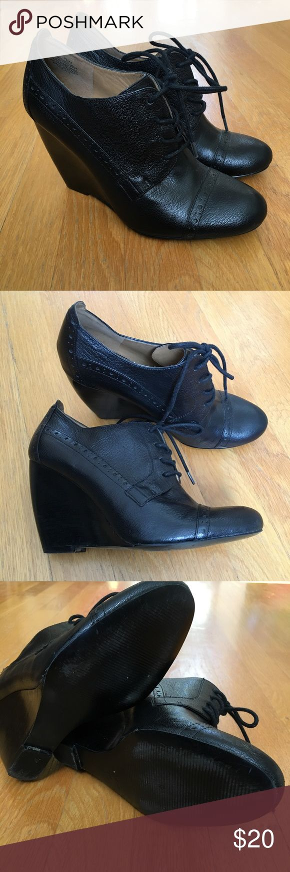 "Nine West Black Leather Oxford Wedges Gently worn lace-up black leather Oxford wedges. Heel height is 4"". Nine West Shoes Wedges"