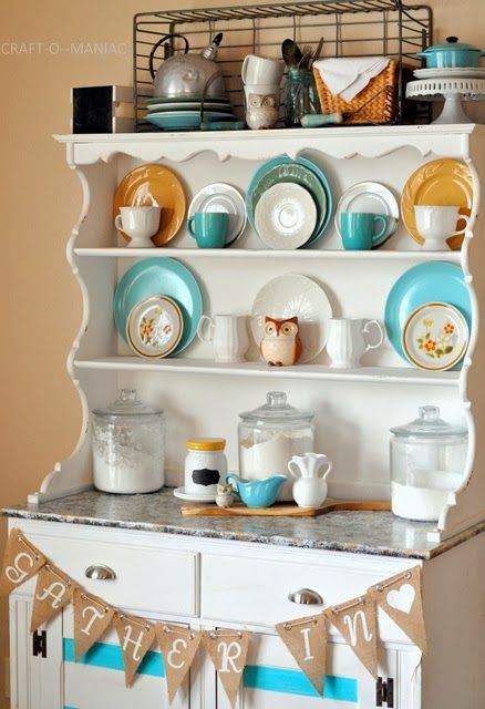 I like the color combo.  Rustic yellow, bright blue and shades of white.