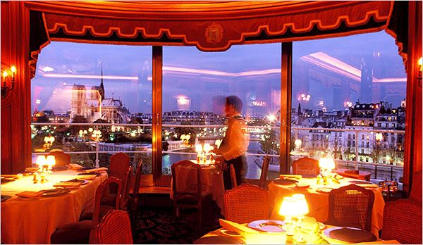 La Tour d'Argent in Paris, overlooks the Seine, Notre Dame and serves legendary duck.  Best wine cellar---I want to go here one day....