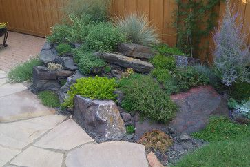 small rock garden, spilling, creeping plants and flowers