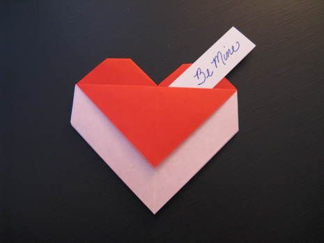 How to fold an origami heart envelope - slip a love note, a piece of chocolate or even a diamond ring into your heart envelope.
