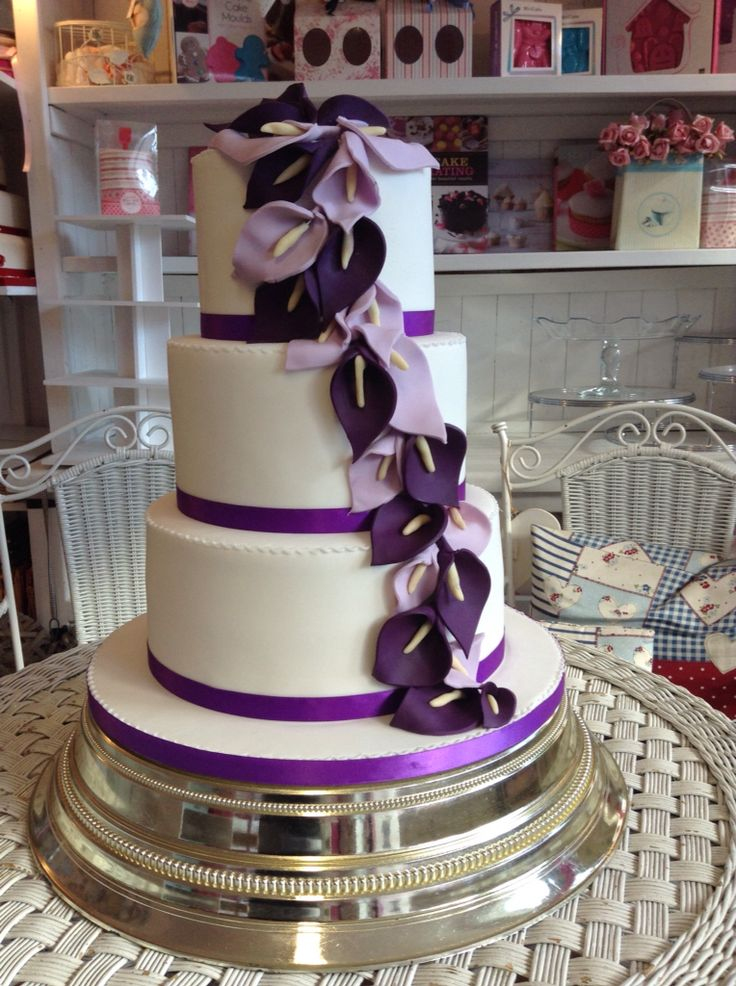 A classic 3 tier wedding cake with handcrafted falling lillies in three gorgeous flavours Victoria sponge with buttercream and jam, chocolate fudge cake and lemon drizzle