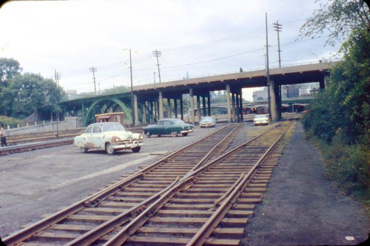 Cars parked in the trainyards on the east side of the Rideau Canal, just south of the Laurier Ave. Bridge in the late 1950s. Through the bridge you can see Union Station in downtown Ottawa. Tad bit of rust on that first car!