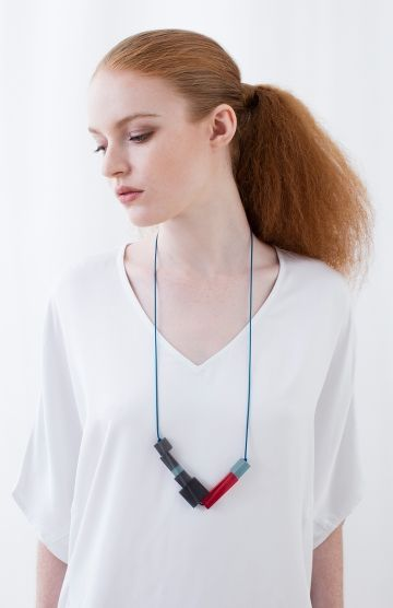 An everyday piece, the Cube Tipped Resin Pendant adds a strong pop of colour to any outfit. Square and rectangular shaped beads anchor the pendant to sit nicely against the body. An adjustable cord means you can wear this piece as a long or short necklace. Ideal to wear against V Neck tops or dresses to complete an outfit.