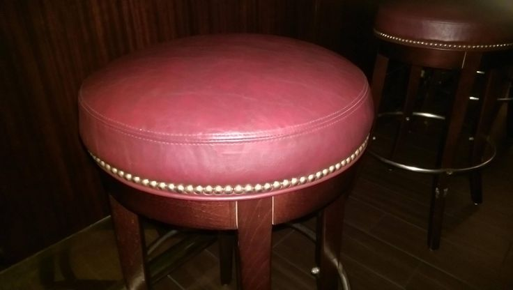 The short stools you see in these pictures were reupholstered for The Capital Grille in Biltmore Fashion Park. This is a super nice place to enjoy dinner and a glass of wine! https://www.eymupholstery.com/