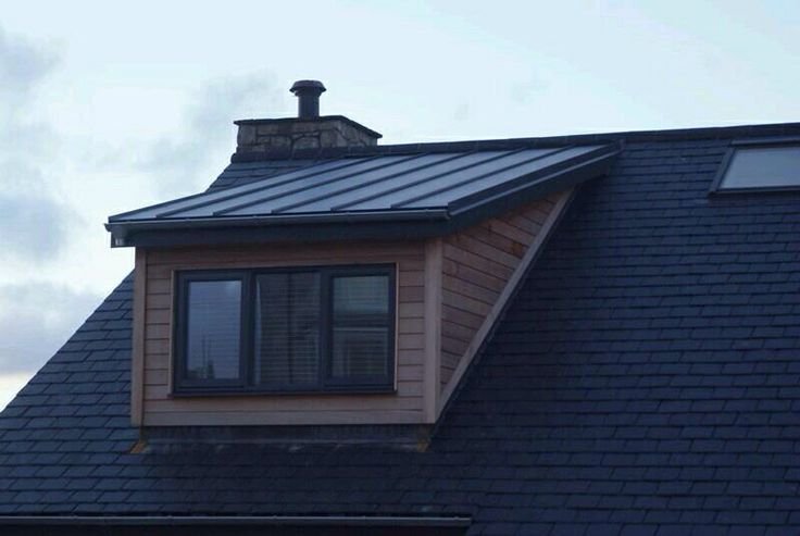 Colorcoat urban roof and wood cladding for my dormers, lovely!!!