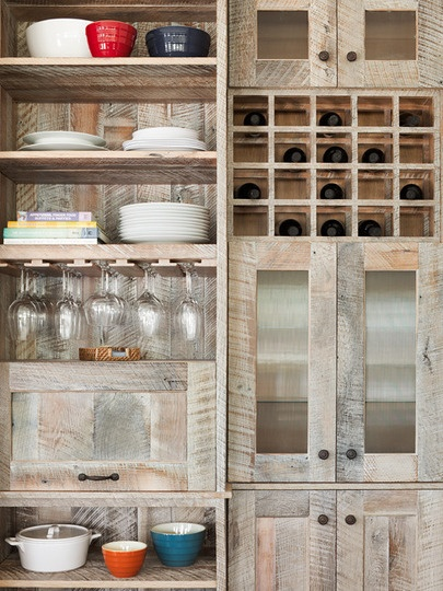 Reclaimed wood can be as blatant or as subtle as you want. Keep the edges rough for more rustic look; sand it smooth and paint it for something more modern. From flooring to cabinets and countertops, it works anywhere.