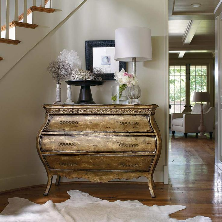 gold console with hide for entry way