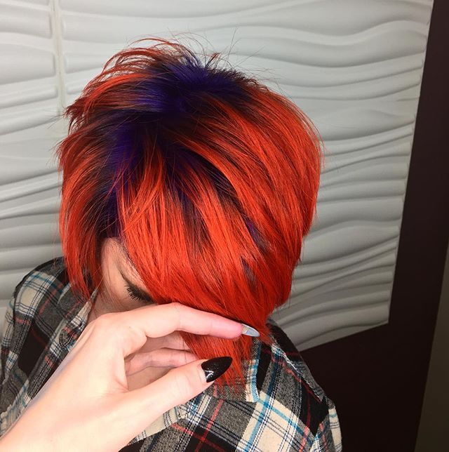 My creation of the day on a fellow coworker. I don't know why my hand is in the picture, I guess I just felt the need to keep touching it  purple roots with orange on her ends, so much fun!