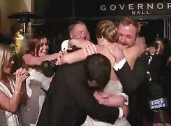 Jennifer Lawrence being hugged by her brothers after winning her Oscar.