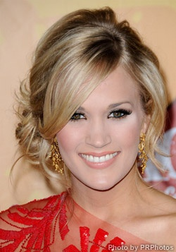 Carrie Underwood pulling off a side-swept messy bun.