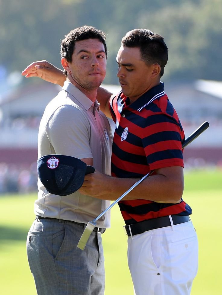 Rickie Fowler Photos Photos - Rory McIlroy of Europe shakes hands with Rickie Fowler of the United States after the Europeans won their match during morning foursome matches of the 2016 Ryder Cup at Hazeltine National Golf Club on October 1, 2016 in Chaska, Minnesota. - 2016 Ryder Cup - Morning Foursome Matches