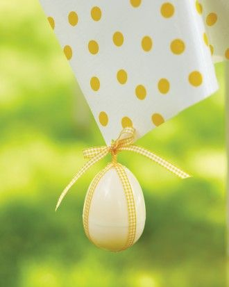 Use a plastic egg filled with jelly beans to anchor your tablecloth; gingham ribbon is secured around the egg with hot glue and threaded through a hole that has been punched in the oilcloth.