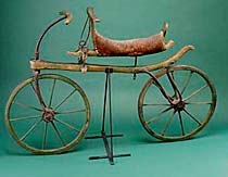 Draisine (Early Bicycle), around 1818.  One of the oldest surviving ancestors of the modern bicycle, this wooden two-wheeler is named for its German inventor, Baron Karl von Drais. Also known as a velocipede or hobbyhorse, the draisine enjoyed brief popularity in Europe and the United States during the 1810s and 1820s. To propel the machine, riders pushed along the ground with their feet. In 1863 a new invention, the pedal, helped transform the bicycle into a more practical and widespread…