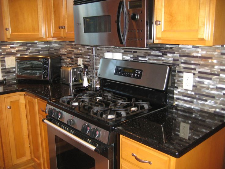 Glass Backsplash And Granite | ... Galaxy Granite Countertop And Black  Glass Tile Backsplash