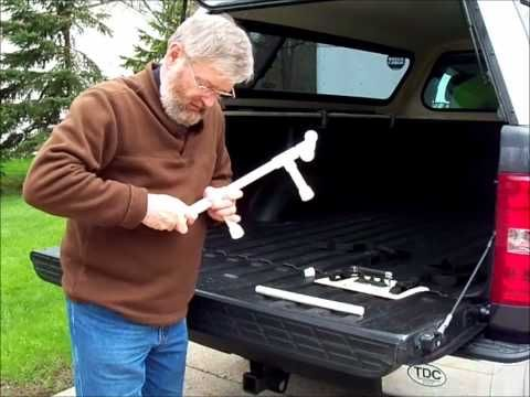 inexpensive pickup truck bed bike rack. - secures into hinge groove